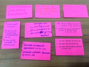 A picture showing bright pink post-it notes on a table. On the post-it notes participants of the focus groups have written their suggestions for the format of the email address